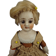 """4 3/4"""" Bisque Doll with Glass Eyes and Rare Sculpted Legs"""