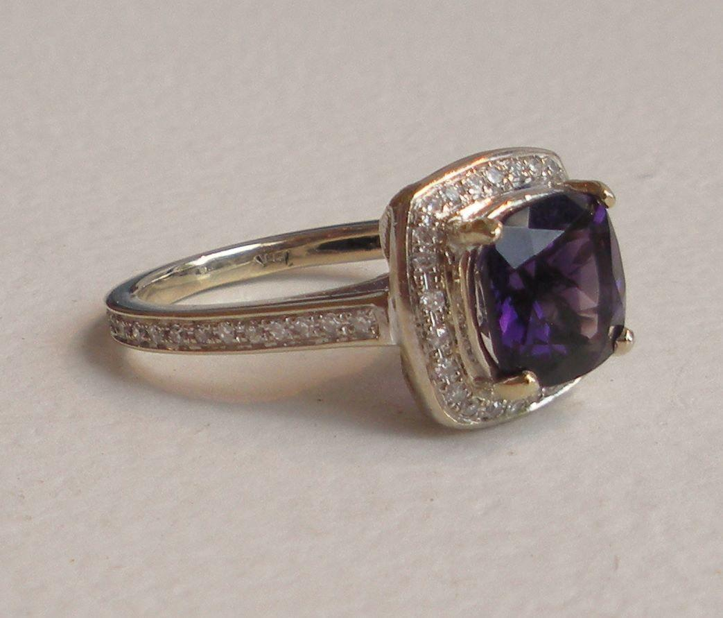 vintage amethyst halo engagement ring from