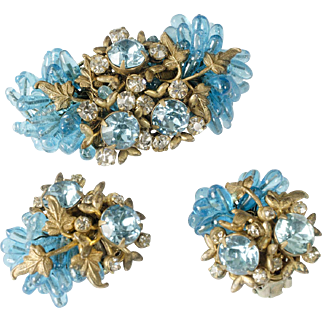 brilliant Miriam Haskell Pin / Brooch and Earrings set brass filigree with clear and aqua rhinestones and blue art glass