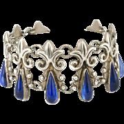 Mexican Deco silver repousse Bracelet ~ Taxco fleur-de-lis links with azur blue art glass teardrops