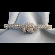Dazzling Signed Goldtone and Pave Rhinestone Knot Hinged Bangle Oval Bracelet