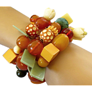 Upcycled Bold Wrap Bracelet of Vintage Bakelite and Celluloid Beads and Buttons