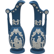 Pair of Blue Bisque Jasperware Ewers with Classical Figures in Relief