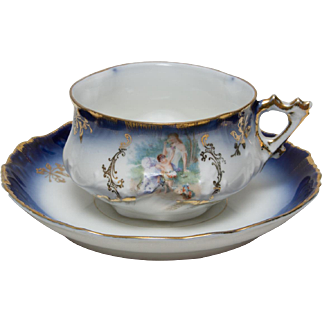 Gorgeous Antique Flow Blue Cup and Saucer with Lady and Cherub