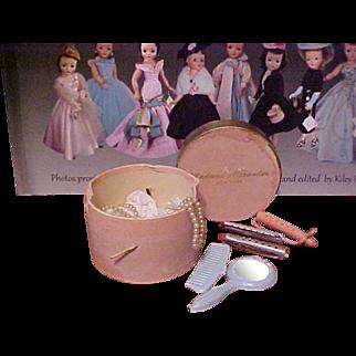 Madame Alexander vintage pink curler box, contents, fan, pearls