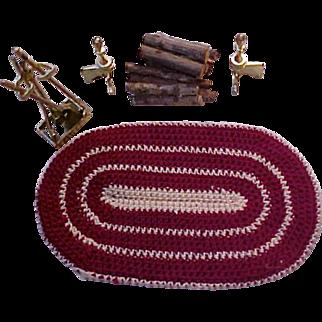 Dollhouse oval rug, wood pile, brass andiron set, fireplace utensils