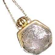 Old vintage Avon glass and gold tone perfume purse with chain