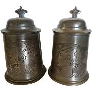 A Pair of Antique Lidded Pewter Beer Steins Engraved with Art Nouveau Portraits and Dated 1904