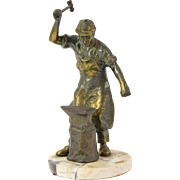 Vintage Spelter Bronze Blacksmith Wielding Hammer over Anvil