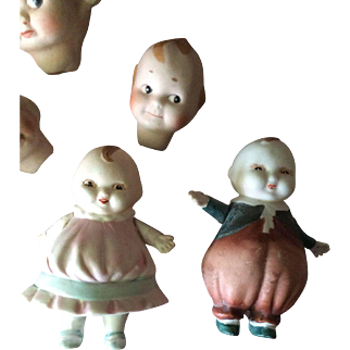 Pair Nippon Happifat dolls -all-bisque plus four interesting heads.