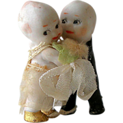 Old Kewpie Huggers All Bisque Painted Clothed Bride and Groom Cake Topper early 20th C