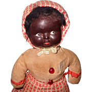 Early Black Saw Dust Filled Composition Character Doll