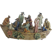 Magnificent eight Asian Mudmen w/Porcelain glazed colorful apparel posed on ceramic boat-(junk)