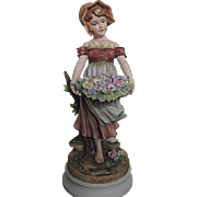 Exquisite Sadek Bisque figurine of Country Girl carrying a Large basket of Flowers - 7735 by Andrea