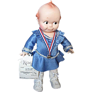 "Large 1983 Kewpie Cameo Doll by Jesco - ""Kewpie Goes Ice Skating""  w/gold medal"