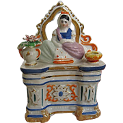 Early 1900's Porcelain Staffordshire Fairing - Girl sitting on Dresser Trinket Box - made in England - No. 1288.