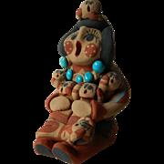 Caroline Sando-Jemez pueblo-Storyteller sculpture