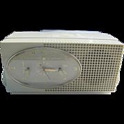 Vintage Golden Shield Tube Clock Radio by Sylvania - 50's era