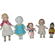 Five Japanese Miniature Bisque Dolls
