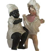 Victorian Figurine of Children with a Doll