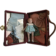 Miniature, All Bisque Doll and her Trunk