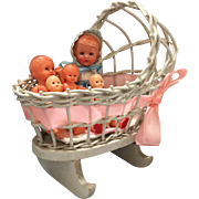 Wicker Baby Bed and 5 Hard Plastic Dolls