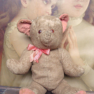 Poor little antique bear is looking for a new home.