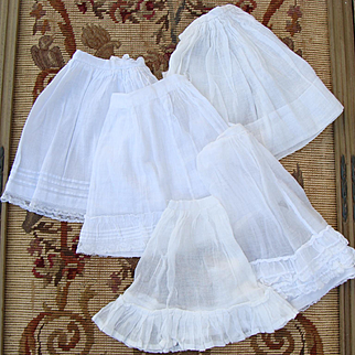 Big lot of antique french fashion petticoats.