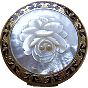 Powder compact by New Light mid century carved mother of pearl