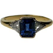 Emerald Cut Sapphire and Trilliant Cut Diamond Ring