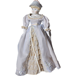 Parian bisque doll with molded bonnet