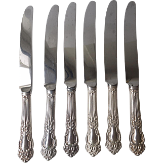 "Tiger Lily Silver Plate pattern by Reed and Barton-7 knives 9 1/2"" long-"