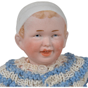 Smiling R. A. Character Baby with Molded Hat - 8 Inches