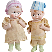 Pair of All Bisque Googly Dolls with Molded Caps - 5 inches tall