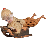 German Boy on Sled Candy Container - 7 inches long