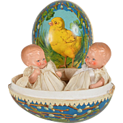 Adorable Painted Bisque Twin Babies in Easter Egg - 5 inches tall