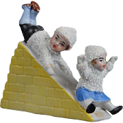 Fine Quality All Bisque Snow Baby Children Figurine on Slide