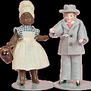 Two Dollhouse Dolls