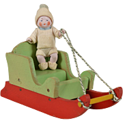 All Bisque Candy Baby in Wooden Sleigh