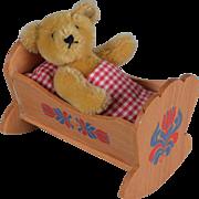 Tiny Steiff Teddy Bear in Original Cradle