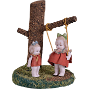 Hertwig All Bisque Dolls with Original Tree and Swing
