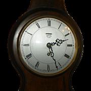 English Walnut Barometer, thermometer, and eight day movemnt clock.  Circa 1920