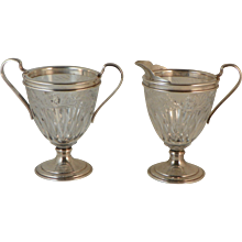 Pair of Cream and Sugar.  Sterling and Crystal.  Circa 1915.