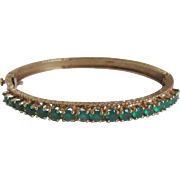 Lady's 14k Yellow Gold and Emerald Hinged Bangle