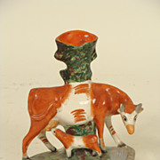 Staffordshire cow spill vase