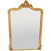 Louis XV style gilt wood mirror