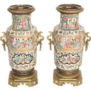 Pair of gilt bronze mounted famille rose vases