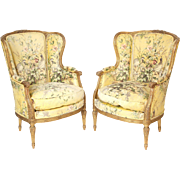 Pair of Louis XVI style gilt wood bergeres