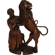 wood carving of Daniel and the Lion
