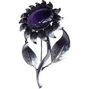 Flower Brooch With Purple Glass Cabochon Marked Sterling Silver